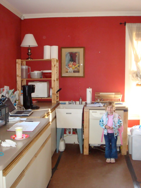 Temporary kitchen, complete with dishwasher (the machine, not the kid)
