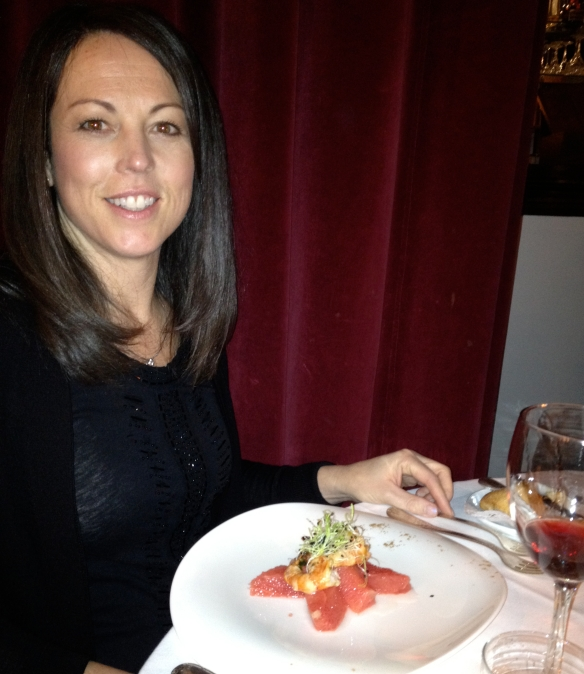 Gena in Paris with a leek microgreen-topped shrimp and grapefruit salad.