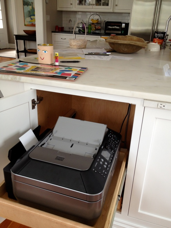 Same trick for the printer. It's nice to have it near homework central, but out of sight when not needed.