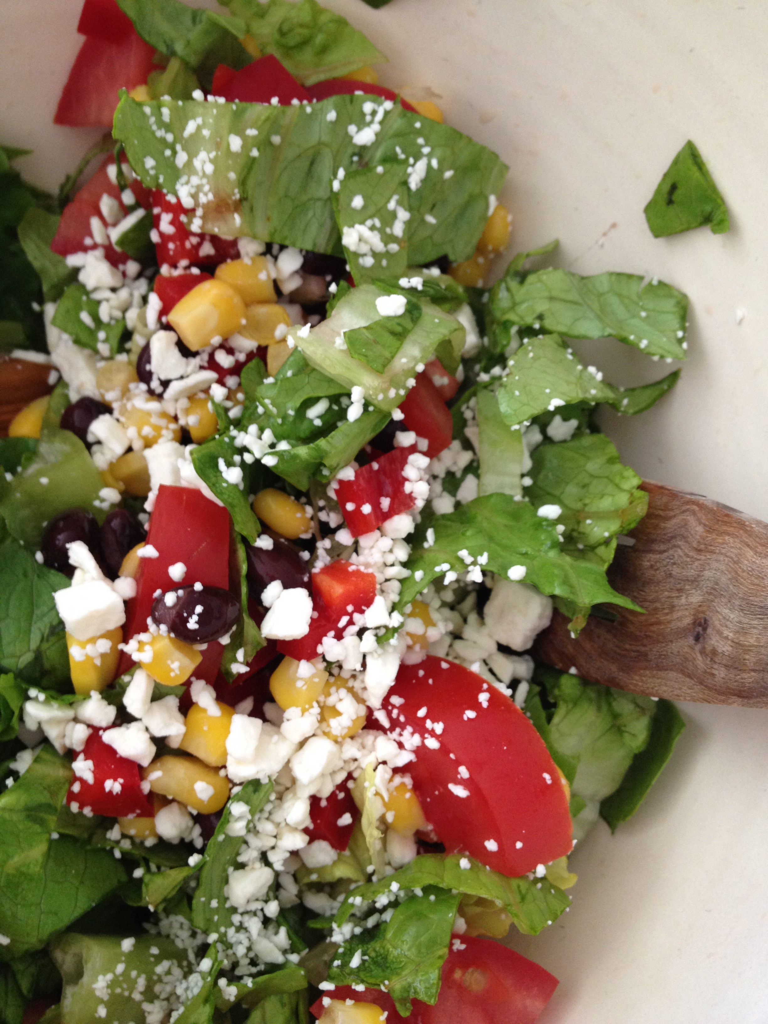 ... dressing over salad and toss. Toss in crushed tortilla chips right