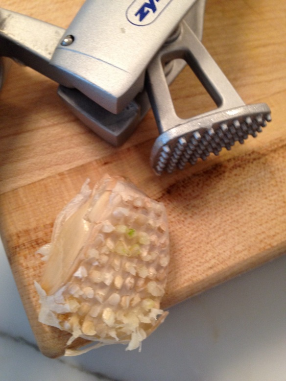 Keep the papery garlic clove skins on when using a press; the skins will lift right out afterwards.