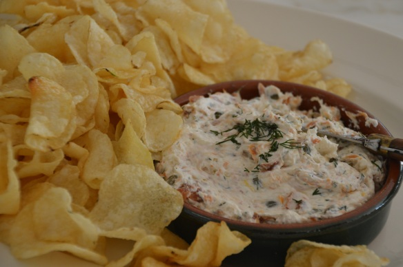 Smoked salmon mixed with whipped cream cheese, fresh dill, lemon zest and capers. Served with thick potato chips for a gluten-free option.