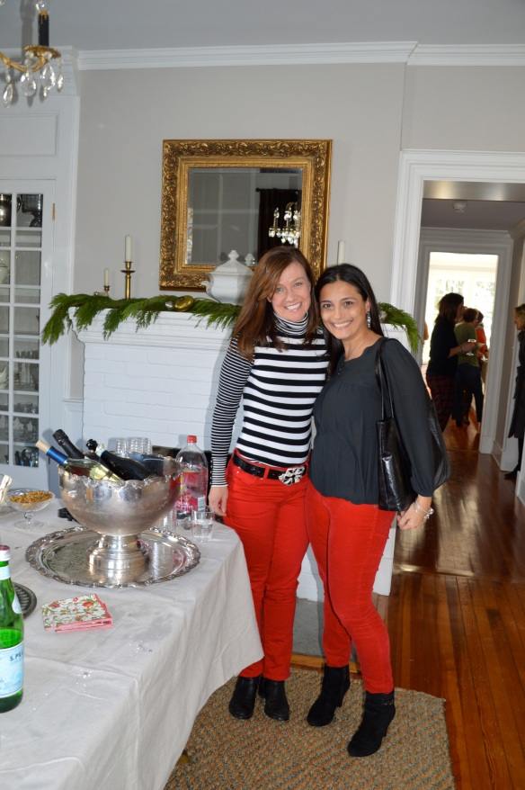 The red pants ladies at the dining room drinks station. Wine chiller is a vintage punch bowl. Table cloth is not expensive French linen but rather a Home Depot drop cloth!