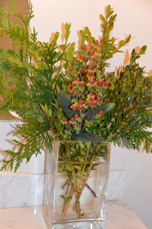 Inexpensive (yet chic!) arrangement of backyard greens and grocery store hypericum berries.
