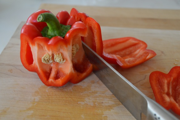Cut around the core of bell peppers, then cut off the bottom.