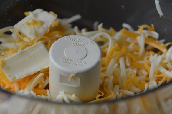 I add the cheese and butter to a food processor and then go do other stuff while it comes to room temperature.