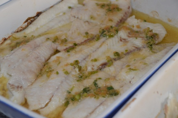 Baked fluke with white wine and ginger scallion butter.