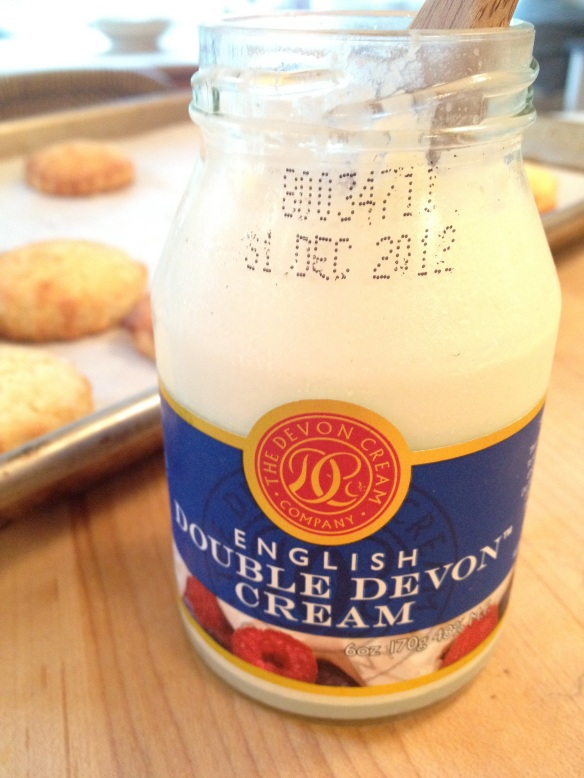 English clotted cream is delish on warm scones. (This is an old photo -- I was not using expired cream!)