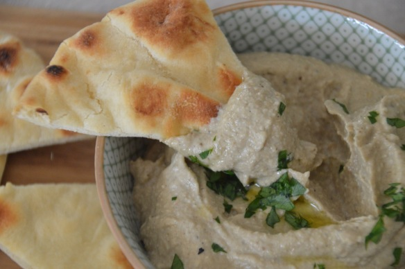 I love toasted (in the toaster oven) naan bread, cut into wedges with this dip. However, if not serving immediately, pita chips are better.