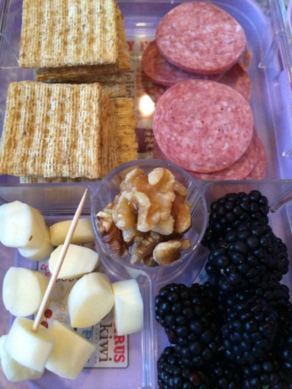 Triscuits, salami slices, cross-cut string cheese, walnuts and blackberries. And a toothpick for spearing.