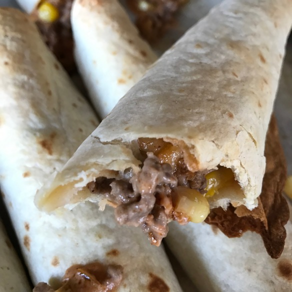 baked-cheeseburger-taquitos